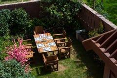 Garden Patio. Table setting in a backyard patio Stock Image