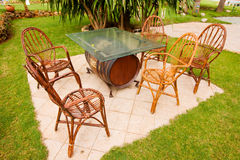 Garden Patio. Backyard patio in the rainy morning . Outdoors table and 5 chairs, close-up Royalty Free Stock Photos