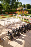 Garden patio with chess game Stock Images