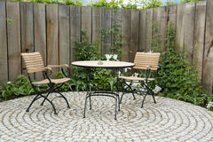 Garden patio. Hidden garden patio with table and chairs Royalty Free Stock Photography