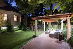 Garden with patio at night. Photo of garden with covered patio at night Royalty Free Stock Photos