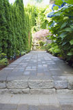 Garden Paver Path Walkway. Garden Pavers Path Walkway with Landscaping Lights Leading to Backyard Royalty Free Stock Photography