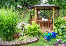 Garden pavilion by the pond Royalty Free Stock Photo