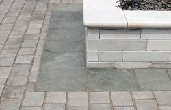 Garden paving example. Paved garden detail shot of raised bed a neutral and popular low maintenance landscaping feature for any outdoor space Stock Photo