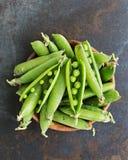 Garden Peas. Fresh picked organic garden peason rustic backgroung Stock Photo