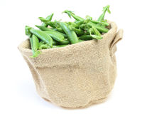 Garden peas in a jute bag Stock Images