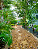 Garden and pebbled pathway stock photo