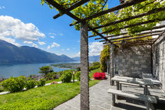 Garden with pergola. Beautiful garden with pergola of a villa, lake view Royalty Free Stock Photo