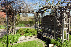 Garden pergola gazebo arbor. Beautiful small wooden garden pergola gazebo arbor Royalty Free Stock Photography