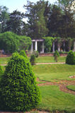 Garden with pillars. Pretty garden with greek style pillars in the background Royalty Free Stock Photo