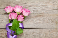 Garden pink roses bouquet over wooden table Stock Photo