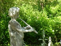 Garden Piper. Garden statue of Greek God Pan Stock Image
