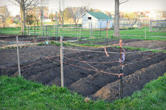 Garden Plot. A community garden plot all tilled and ready for planting in Prairie Crossing neighborhood in Grayslake, Illinois - Lake County - United States of Stock Photos