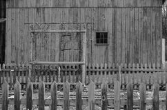 Garden Plot by an Old Barn. A black and white photo of a garden plot next to an old barn Royalty Free Stock Photos