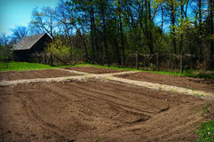 Garden Plots Freshly Tilled. In the foreground with a garden shed in the background.  Taken at Old World Wisconsin in Eagle, WI Stock Photo