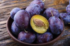 Garden plums in bowl. Organic food. Top view with copy space for your text Stock Images