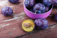 Garden plums in bowl. Organic food. Top view with copy space for your text Royalty Free Stock Photos