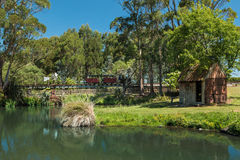 Garden Pond. Garden large pond with a garden shed by it and a train going around too Stock Photos
