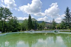 Garden pond in small mountain town Royalty Free Stock Images