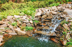 Garden pond and waterfall Royalty Free Stock Image