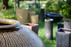 Garden pots. Earthen pots in a garden arranged as part of landscaping Royalty Free Stock Photography