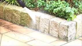 Garden, pressure washer, electric, cleaning stones stock video footage