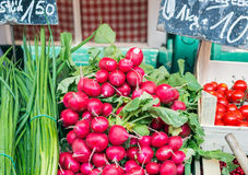 Garden radish and spring onions on a market stall Royalty Free Stock Photography