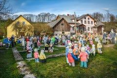 Garden of rag dolls. Garden full of dolls puppets, dressed up as singers, policemen, sportsmen, families etc. Shot in Sabile, Latvia stock images