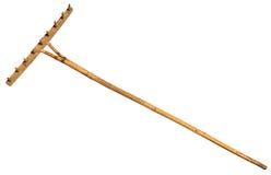 Garden rake isolated on white. Vintage Retro. Wooden Rake Handmade royalty free stock image