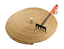 Garden rake and  rope Stock Image