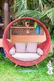 Garden red chair in the garden Stock Photo