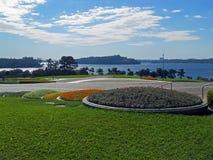 Garden and reservoir Stock Photos