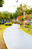 Garden and road in the park. Walking way in garden Royalty Free Stock Photo