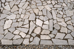 Garden rock pavement with pebbles Stock Photos