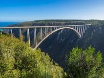 Garden Route - Famous Bloukrans Bridge with ocean in background and bungee jumpers, South Africa Stock Images