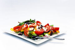 Garden Salad with Baby Greens. Garden Salad With Feta Cheese on white plate Royalty Free Stock Photography