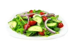 Garden salad on plate, isolated on white royalty free stock image