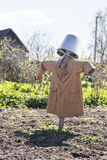 Garden scarecrow in a coat Royalty Free Stock Images