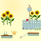 Garden Scene. Illustration of an adorable garden scene with planter boxes, bird house, fence and sunflowers Vector Illustration