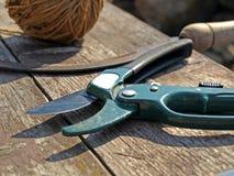 Garden scissor. A gardening scissor closeup on old wooden table Royalty Free Stock Image