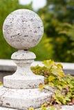 Garden sculpture. Autumn foliage and garden sculpture Stock Photos