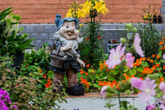 Garden sculpture with a basket Royalty Free Stock Image