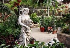 Garden sculpture girl with Vase Royalty Free Stock Photo