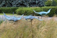 Garden sculpture. Moscow, Russia - July 6, 2018: Manta rays - garden sculpture at Moscow Flower Show royalty free stock photos