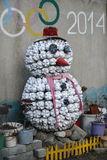 Garden sculpture of a snowman from old plastic bottles Stock Photo