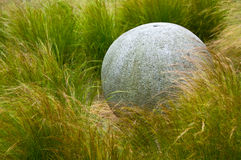 Garden sculpture stone sphere Stock Photo