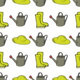 Garden seamless pattern with watering can, rubber boots and hat stock illustration