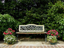 Garden Seat. Garden Bench with two identical pots royalty free stock image