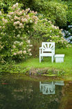 Garden seat by lake Stock Photos