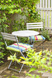 Garden seating area. Image of cozy seating area in lush swedish garden Royalty Free Stock Images